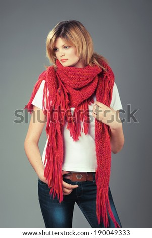 Lovely woman in big pink scarf - stock photo