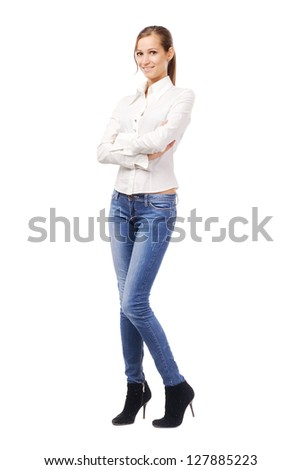 Lovely woman in white shirt and blue jeans, isolated on white - stock photo