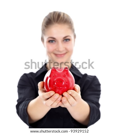 Lovely woman offering us a red piggy bank - stock photo