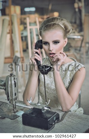 Lovely woman with a phone - stock photo