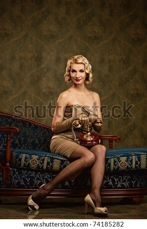 Lovely woman with a phone. Retro portrait - stock photo