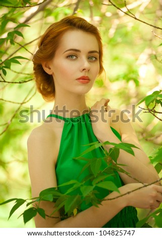 Lovely young caucasian woman in park enjoying the summer - stock photo