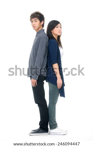Lovely young couple back to back-full body - stock photo