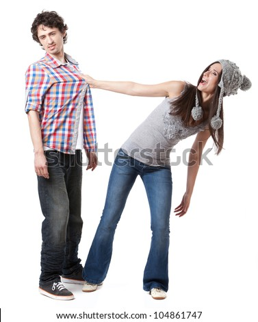 Lovely young couple having fun in studio. - stock photo