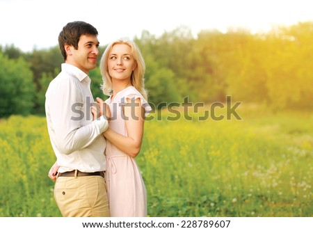 Lovely young couple in love outdoors in summer day - stock photo