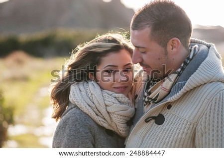 Lovely young couple walking in the park, selective focus - stock photo