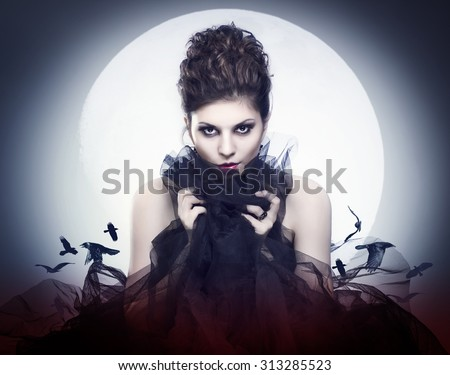 Lovely young female vampire in the night moon. - stock photo