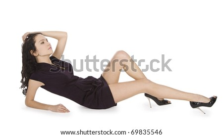 Lovely young lady in black dress lying isolated white background - stock photo