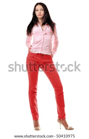 Lovely young woman in red jeans. Isolated - stock photo