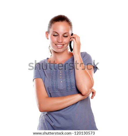 Lovely young woman speaking on cellphone on blue shirt against white background - stock photo