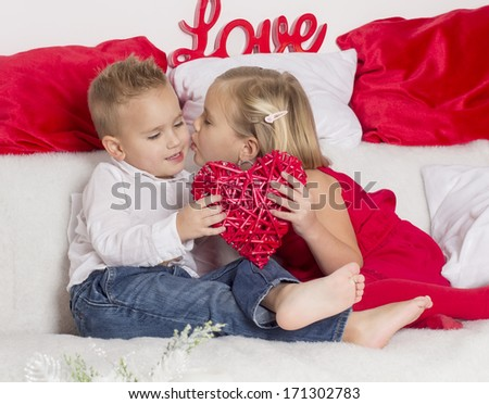 lover boy gives a girl heart and gets a kiss - stock photo