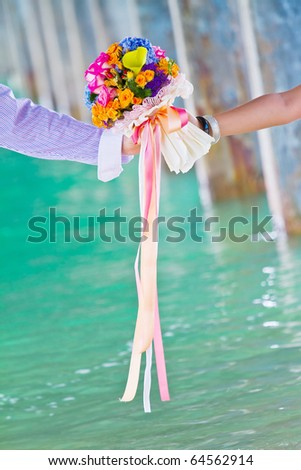 lover holding colorful flower - stock photo
