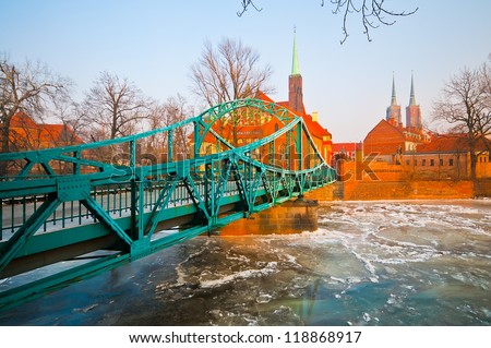 Lovers Bridge and Cathedral in the background in Wroclaw, Poland - stock photo