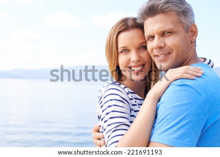 Lovers embracing outdoors - stock photo
