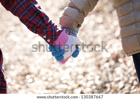 Lovers holding hands - stock photo