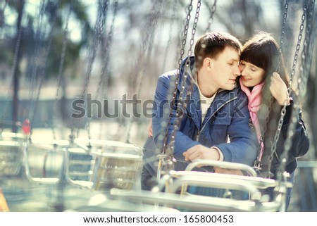 lovers kissing in the park - stock photo