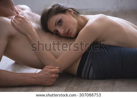 Lovers lie on the floor  - stock photo