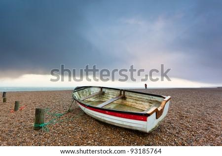Lovers on the beach at Blakeney Point on the Norfolk coast - stock photo