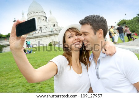 Lovers taking picture of themselves in front of Sacre Coeur - stock photo