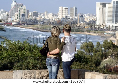 lovers watch the beach and the skyline of Tel-aviv, Israel - stock photo