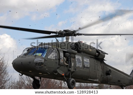 LOVES PARK, IL- APRIL 2: Blackhawk helicopter arriving for display at the Field Of Honor veterans war memorial. April 2, 2011 Loves Park, IL - stock photo