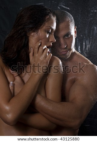 Loving affectionate nude heterosexual couple in shower engaging in sexual games, hugging and kissing - stock photo