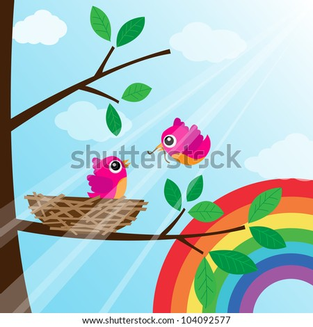 Loving bird feeding with rainbow - stock photo