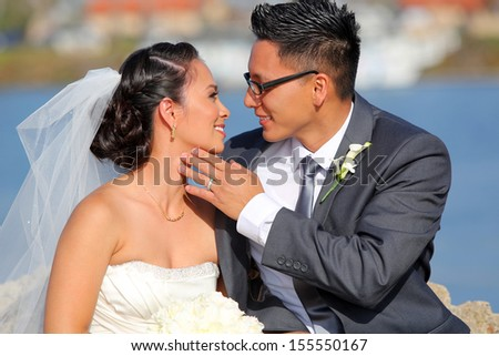 Loving bride and groom at their wedding - stock photo