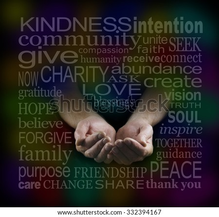 Loving Charitable Word Cloud -  Man's cupped hands emerging from darkness surrounded by a multicolored charity related word cloud - stock photo