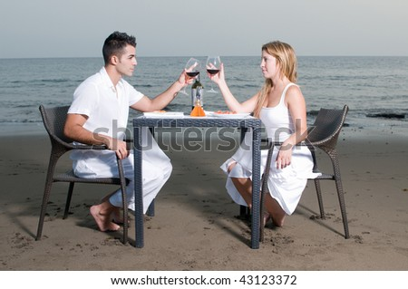 Loving couple at a romantic dinner in the beach - stock photo
