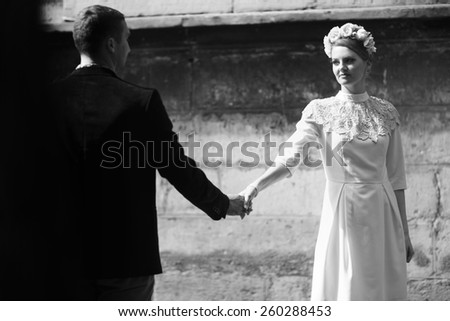 loving couple held hands in the old town - stock photo