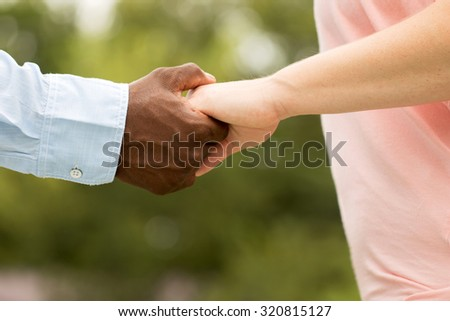 Loving couple holding hands. - stock photo