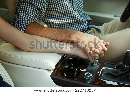 Couple Holding Hands In Car