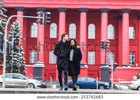 loving couple in a winter day in the city,African girl  and caucasian man - stock photo