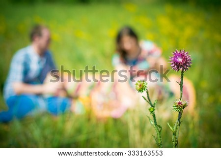loving couple in autumn park out of focus - stock photo