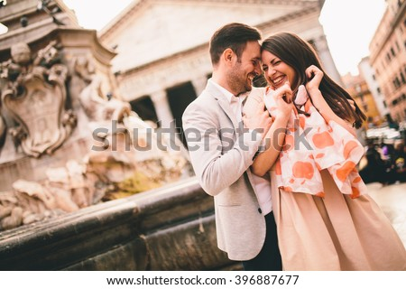 Loving couple in front of the Pantheon in Rome - stock photo