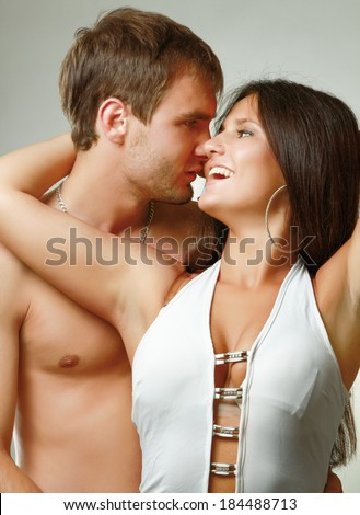 Loving couple isolated on grey - stock photo