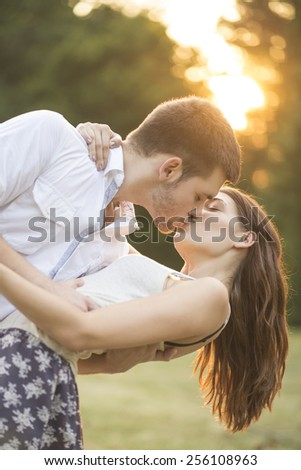 Loving couple kissing and embracing - stock photo