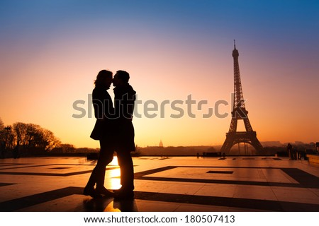 loving couple kissing on Eiffel Tower background, Paris, France - stock photo