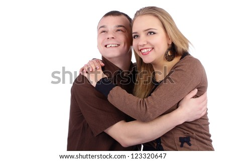 Loving couple looking up smiling and dreaming - stock photo