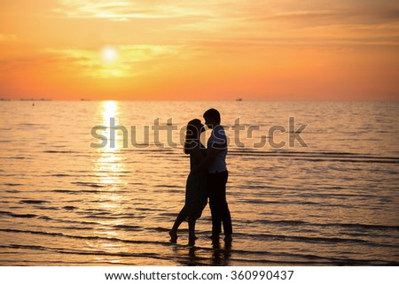 loving couple on the coast, people's attitudes. love story. Copy space. - stock photo