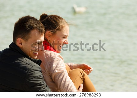 loving couple spending leisure time together at beach hugging side view - stock photo