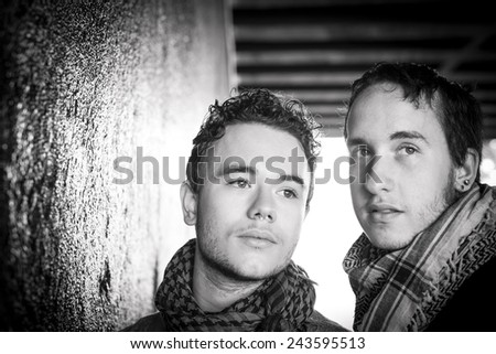 Loving gay couple in outsite. Photographs in black & white - stock photo