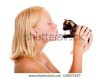 loving little girl kissing a kitten isolated on white - stock photo