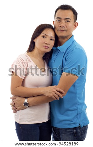 Loving middle aged Asian Couple isolated over white background - stock photo