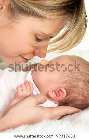 Loving moment of tenderness between a mother and her 18 days old baby - stock photo