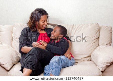 Loving mother and son looking into each other's eyes - stock photo