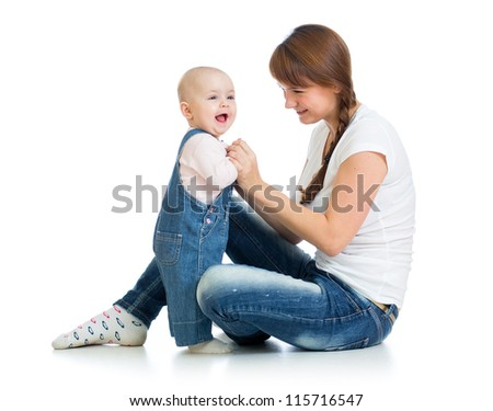 Loving mother playing with her baby girl - stock photo
