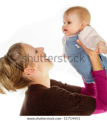 Loving mother playing with her four months old baby girl - stock photo