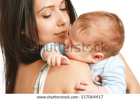 Loving mother with her infant child isolated on white background - stock photo
